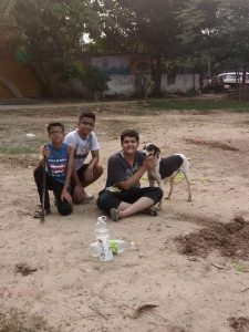 Samarrth (holding the dog) and friends at the site